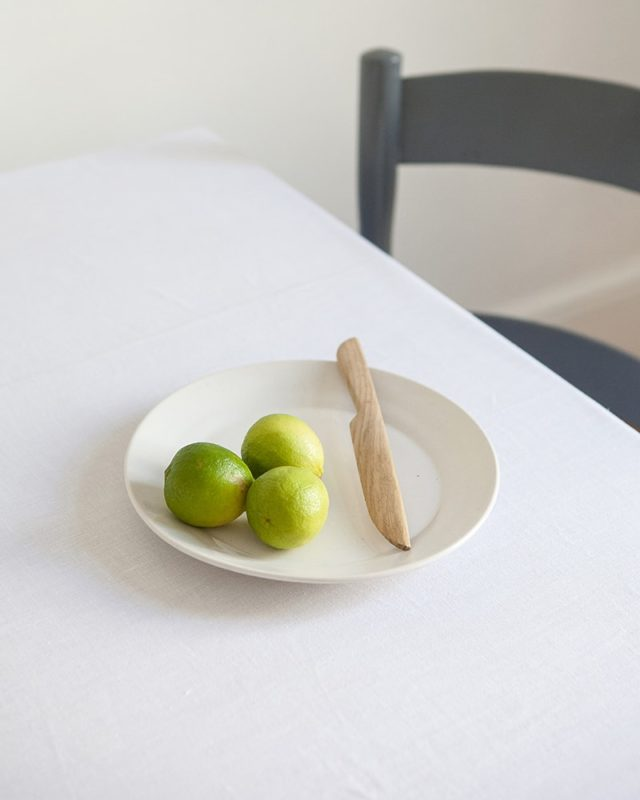 Mungo 100% linen white table cloth in a fresh looking set table scene