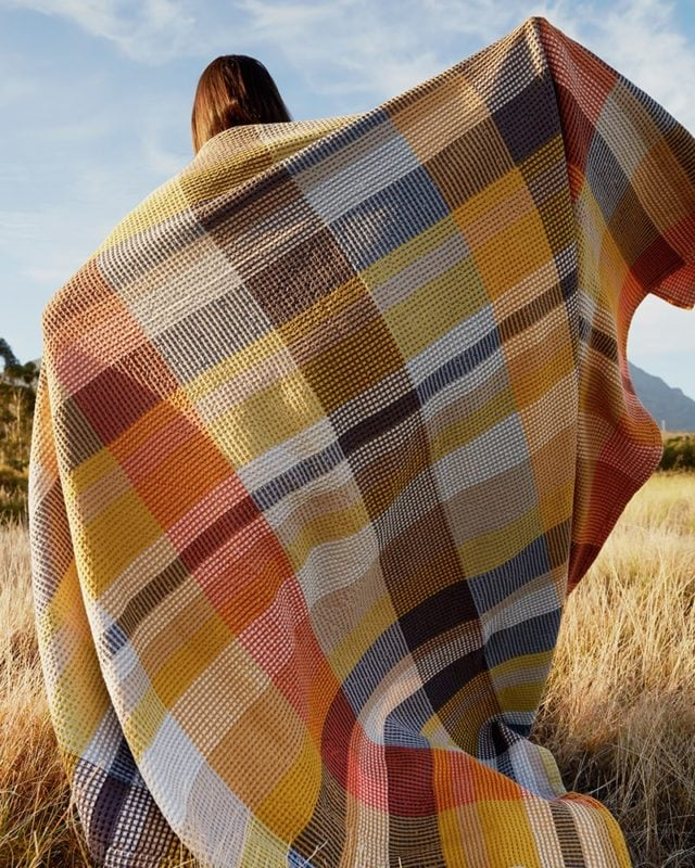 Mungo Vrou Vrou Blanket in Tamarind. Textural pure cotton throws, blankets & bed covers, woven at the Mungo Mill in South Africa