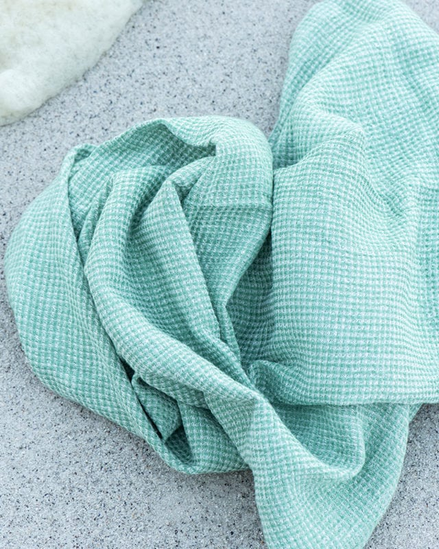 Mungo Dhow Towel in Seafoam colourway. Pure Italian-spun linen, designed & woven in South Africa at the Mungo Mill