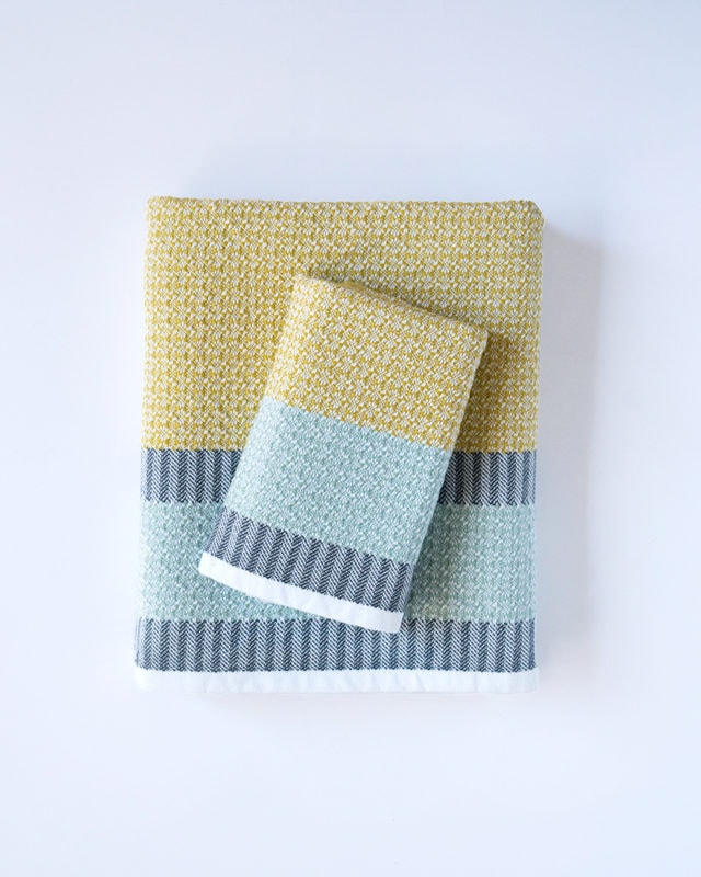 Mungo Bijou Towel in Canary. Compact, colourful, cotton flat weave towel designed, woven & made at the Mungo Mill in South Africa